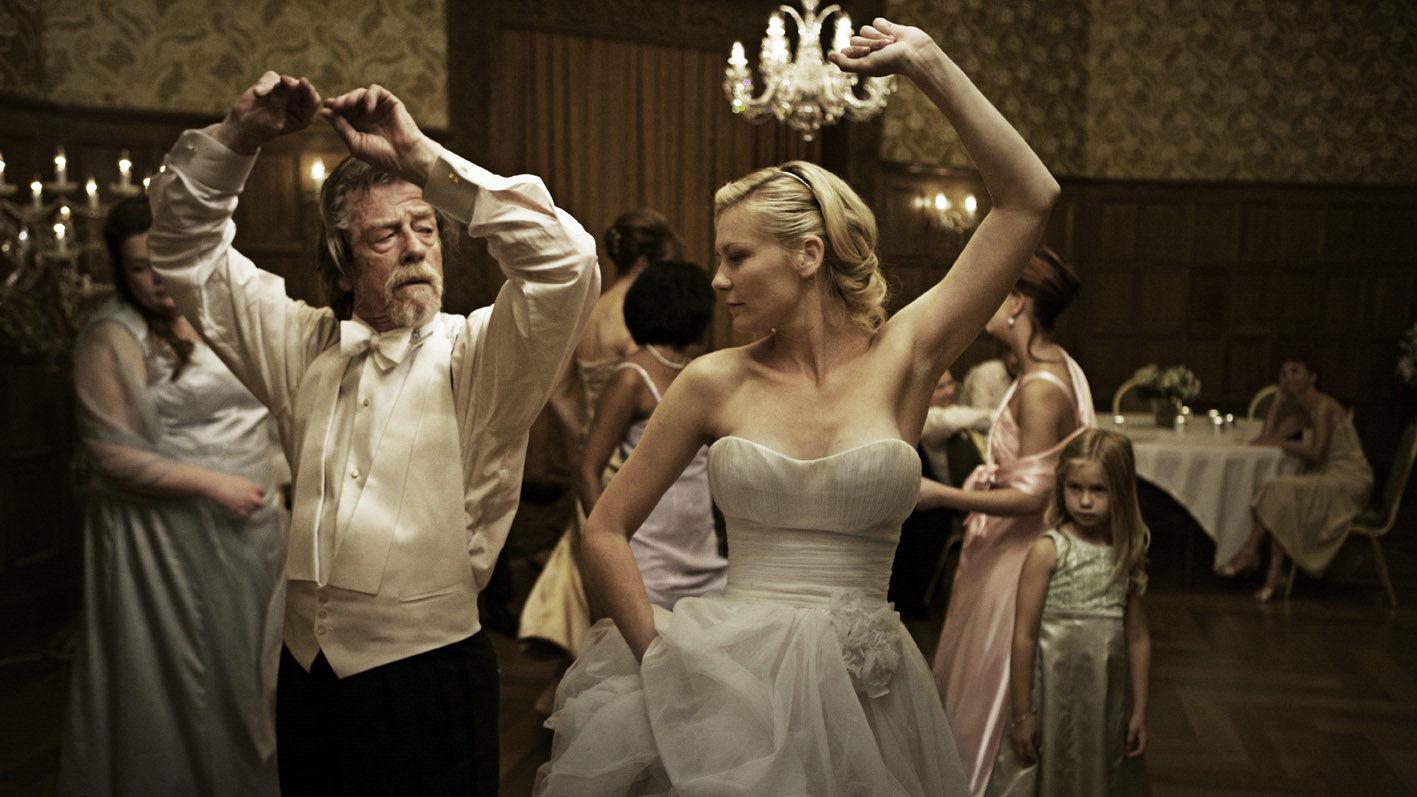 John Hurt e Kirsten Dunst